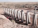 PK 621. Construction of bridge across the Sharbulak river.  Pole erection